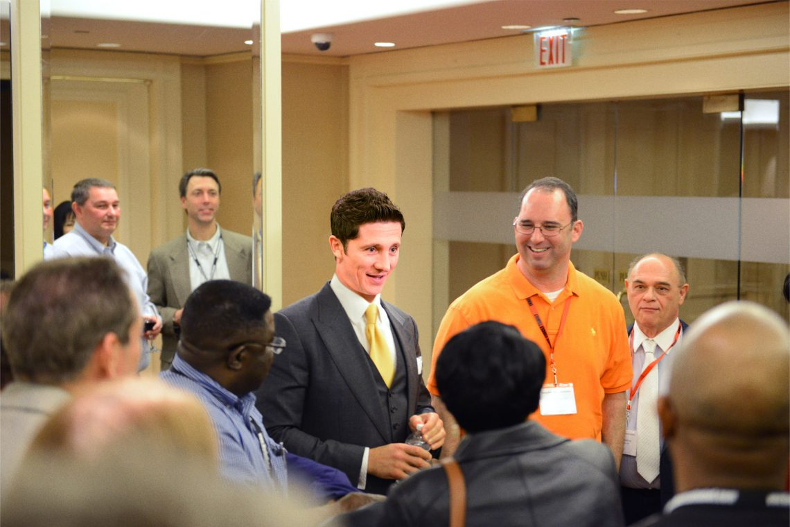 Marko Rubel networking with students